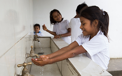 Students wash their hands thanks to a new water well