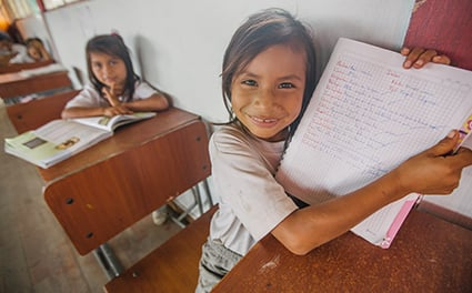 Student in Ecuador sharing her notebook