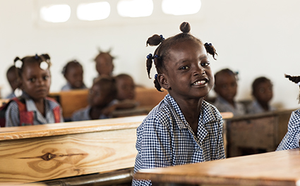 Young student smiling in class
