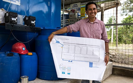 A technician at his water treatment system
