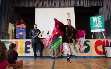 An Indigenous dance performance in a school participating in the WE Stand Together Campaign