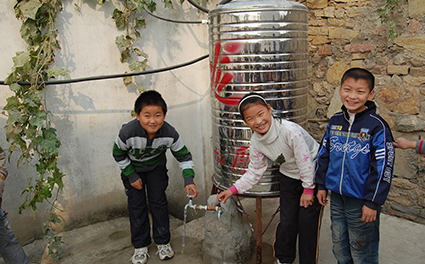 Children using a newly built water filter