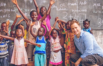 Marc Kielburger with local students in Kenya