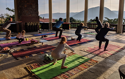 The family taking part in a yoga class.