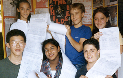 Craig Kielburger and peers with collected signatures supporting Iqbal Masih