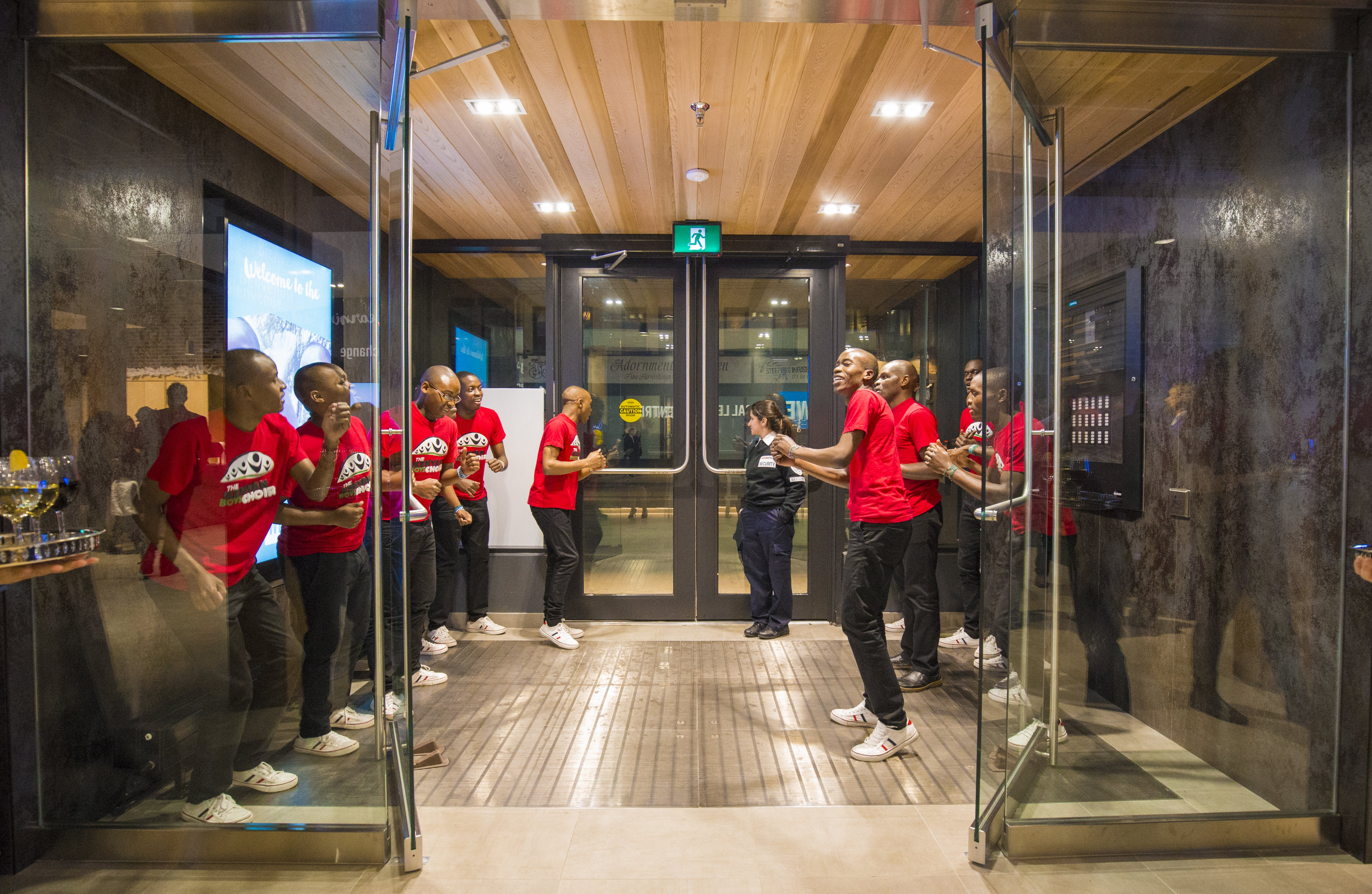 The Kenyan Boys Choir perform in the entrance to the WE Global Learning Center