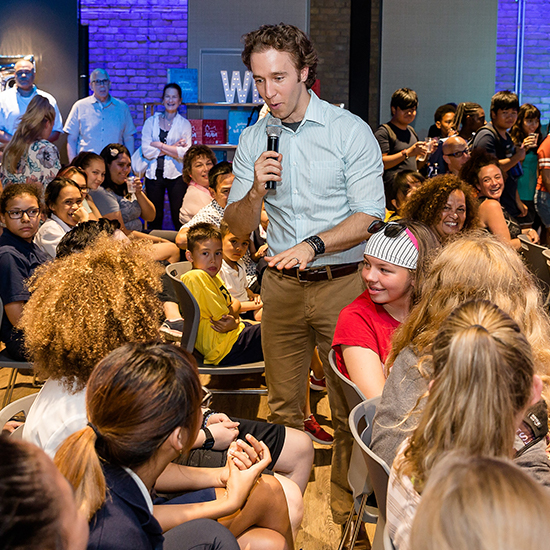 Craig Kielburger speaking to youth at an event