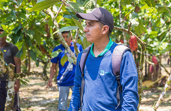 Head instructor Melquiades Coello speaks to cacao farmers at WE Charity's Agriculture Learning Center in Ecuador