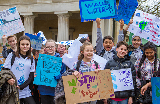 Young WE Schools students rallying for WE Walk For Water campaign