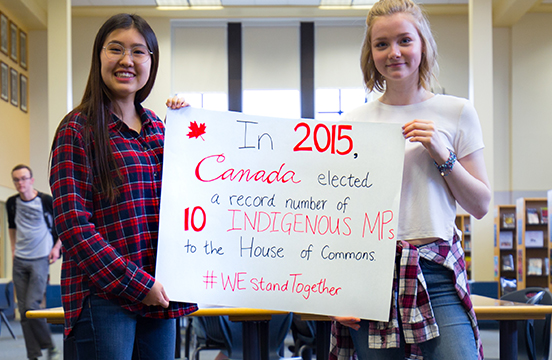 WE Schools students working on a poster for the WE Stand Together campaign
