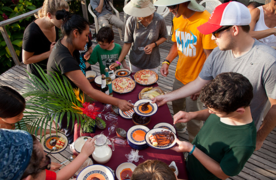 Travellers eating a spread of traditional Ecuadorian food