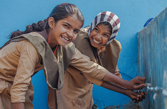 School girls in India at a water tap