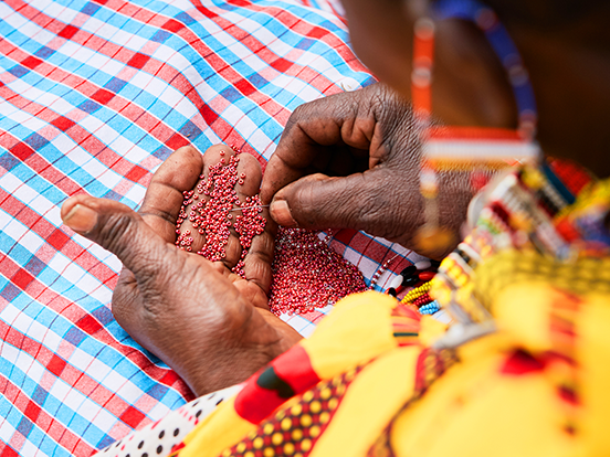 Local woman beading in Kenya