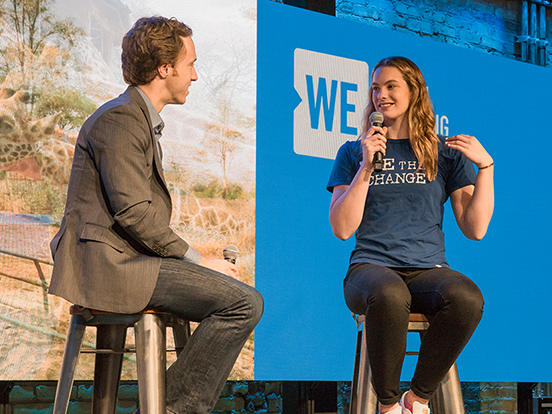 Craig Kielburger and Penny Oleksiak speaking at WE Global Learning Centre
