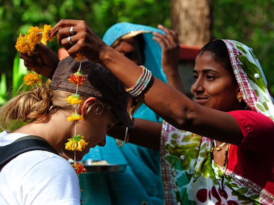 Local woman welcoming traveller in India
