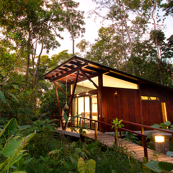 Luxurious Minga Lodge cabin exterior in rainforest