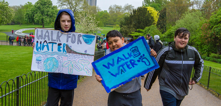 Youth participating in water walk for WE Walk For Water