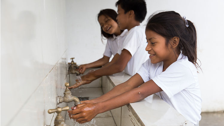 Students washing their hands at school in Ecuador.